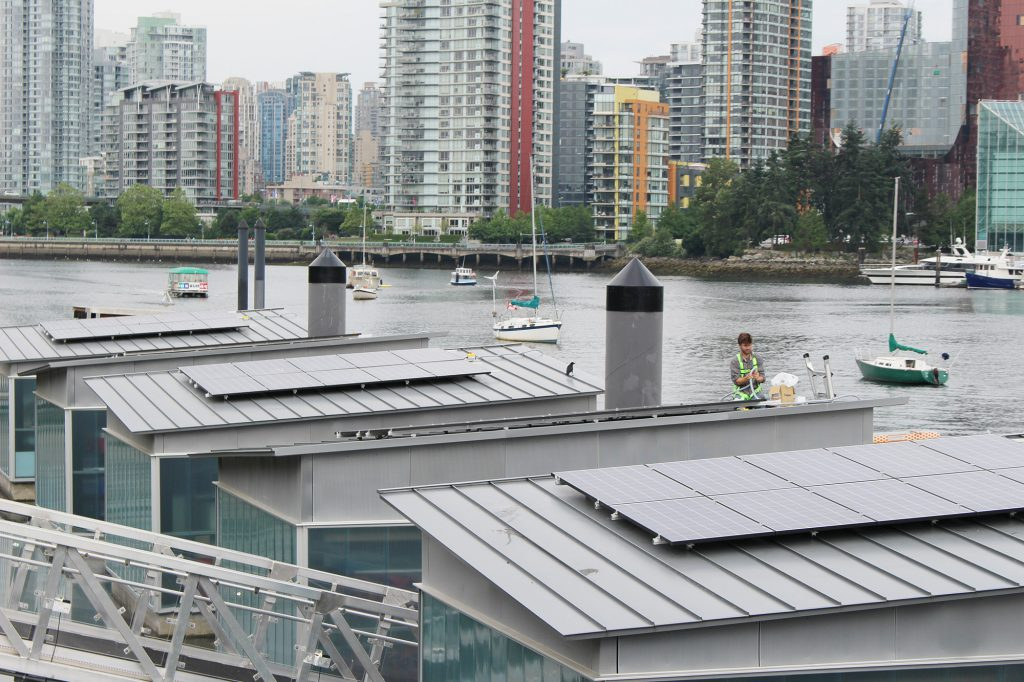 Duncan Martin of Vancouver Renewable Energy installing Creekside solar panels for Solar Now.